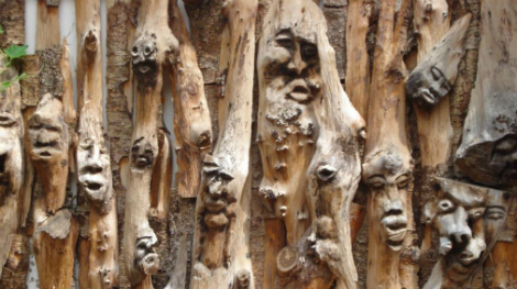 Carved wooden sticks with faces