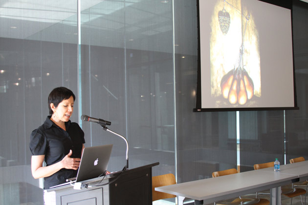 Artist Maria Tomasula discussing her art in presentation on 'Living in History (And Knowing It)' at Thompson Library.
