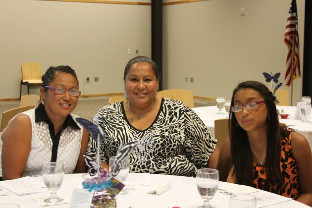 Ms. Masami Smith of Native American Center of Central Ohio, Honoree at Banquet, with family.