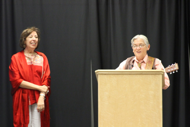 MALCS Tortuga Award Winner Dr. Norma Cantú (in red) and Dr. Rusty Barceló singing in her honor.