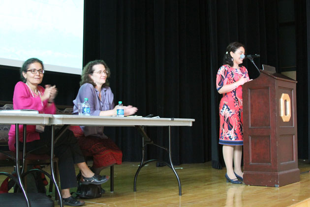 Dr. Lilia Fernandez presenting on 'Latina Activism in the Midwest,' Ohio Union. At table: Dr. Lourdes Torres and Dr. Ana Puga.