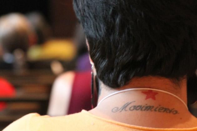Participant's tattoo 'Movimiento'.